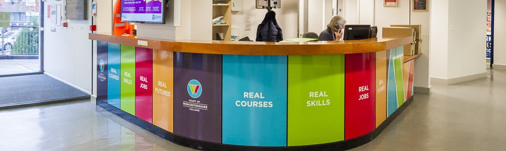 Interior shot of Heart of Worcestershire College's All Saints' reception desk