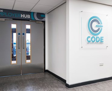 Picture of grey doors into the CODE suite (Centre of Digital Engineering)