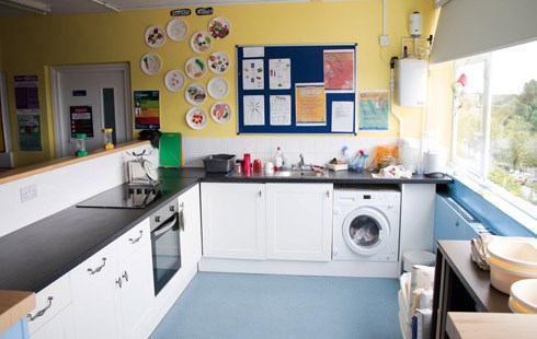 Picture of classroom kitchen with pin-boards on walls with posters and information.