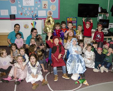 Group photo of nursery children in a classroom and dressed up for their nativity play.
